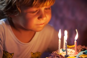 Little boy blows out candles