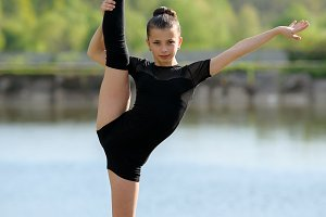 Rhythmic gymnast doing vertical