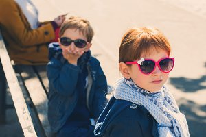 Little funny boy and girl outdoors