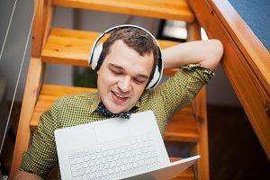 Man entertaining with laptop
