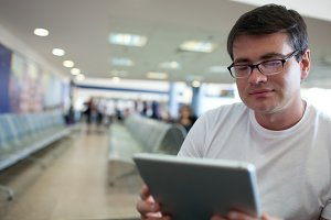 Man reading on tablet PC while