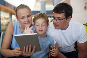 Parents and son with tablet PC
