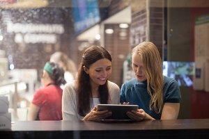 Two women talk cheerfully restaurant