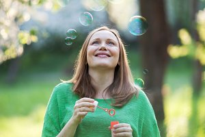 Happy pregnant woman and bubbles