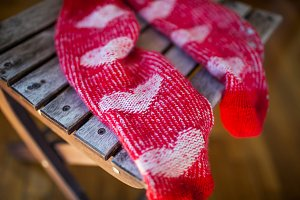 Red socks with heart pattern wooden