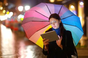 Woman with Tablet PC the Rainy