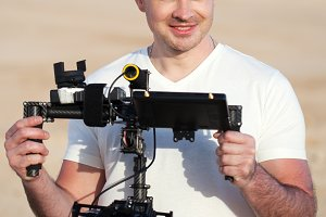 Smiling man with steadicam equipment