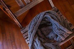 Woollen scarf lying on wooden chair