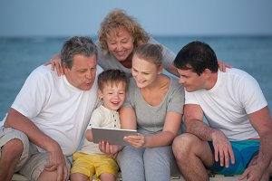 Happy big family with tablet PC