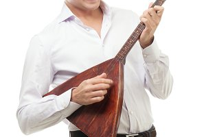 Excited young man playing balalaika