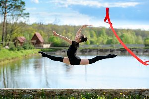 Rhythmic gymnast girl exercising wit