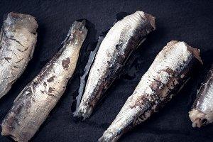 Sardines on the black stone board
