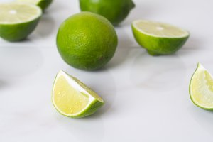 lime and slices on a white backgroun