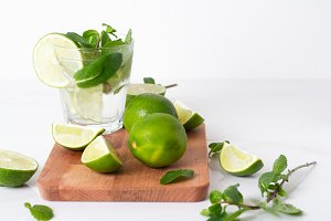 mojito with lime and mint on a woode