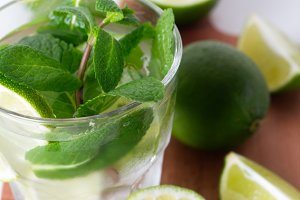 Mojito with lime and mint close up
