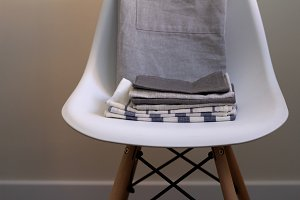 a stack of kitchen towels, napkins o
