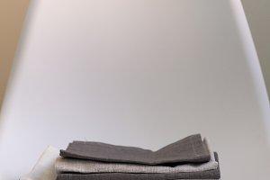 stack of kitchen towels, napkins on