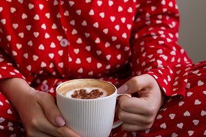 girl in red pajamas holding coffee i