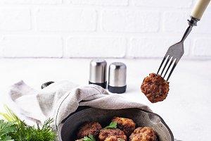 Homemade beef meatballs in frypan