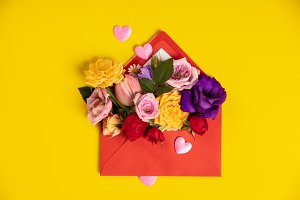 Opened red envelope with flowers arr