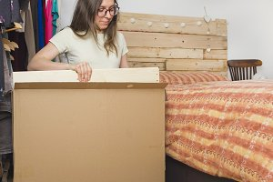 Woman assembling chest of drawers