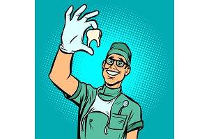 Joyful dentist man. Torn tooth