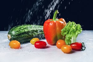 still life with vegetables and water