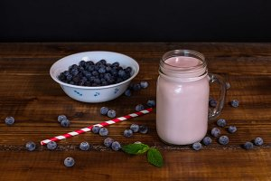 Blueberry smoothie with straw