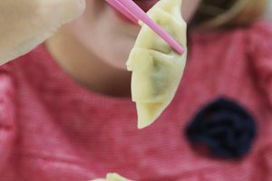 girl eating steamed dumpings.jpg