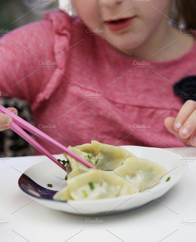Girl eating steamed dumpings 3.jpg - Food & Drink