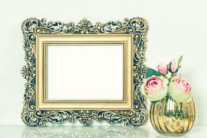 Golden picture frame with flowers