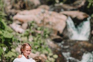 Little girl enjoying view of waterfa