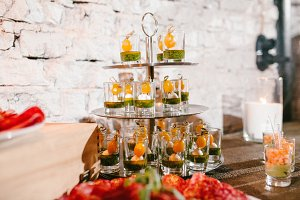 beautiful appetizer in cups on a