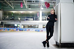 Figure skater woman at ice skating r