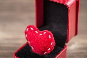 Red felt heart in ring box