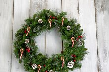 Christmas wreath on old white wood