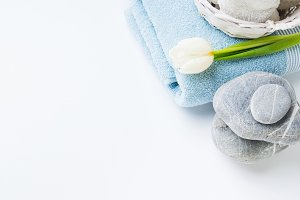 Fresh Towels and stones on white