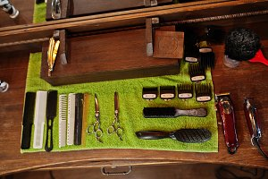 Barber tools on wooden background ta