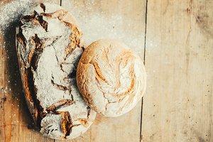 Tasty fresh bread on wooden table