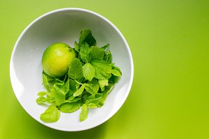 Fresh lime with mint in white cup