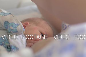 Breastfeeding newborn in maternity
