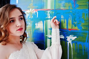 Pretty young gilrl painter in white