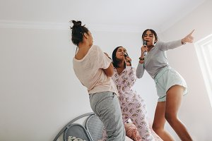 Girls at a sleepover singing