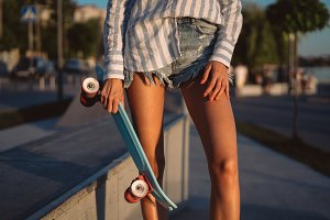 Beautiful legs of the young girl wit