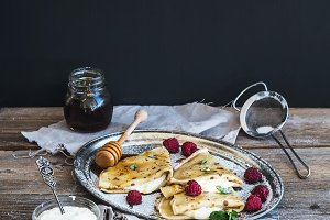 Thin pancakes with fresh raspberry