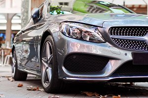 Front part of a grey car