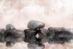 Group of black stones in wather