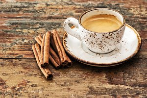 black coffee with cinnamon spices