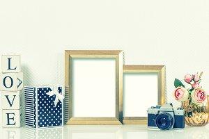 Golden picture frames, roses flowers