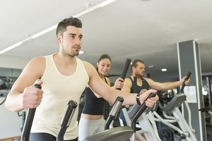 People training at cross trainer ell